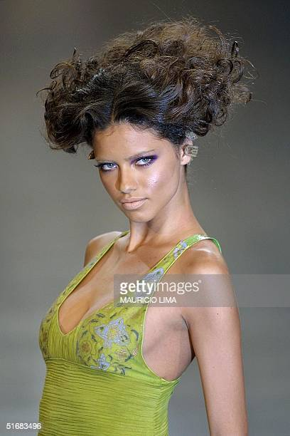 Adriana Lima girlfriend of American signer Lenny Kravitz models a dress by Brazilian designer Lino Villaventura 19 July 2002 during Sao Paulo Fashion...