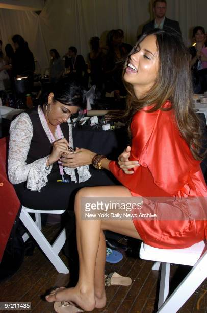 Adriana Lima has her nails done backstage as she prepares for the Victoria's Secret Fashion Show at the Lexington Ave Armory
