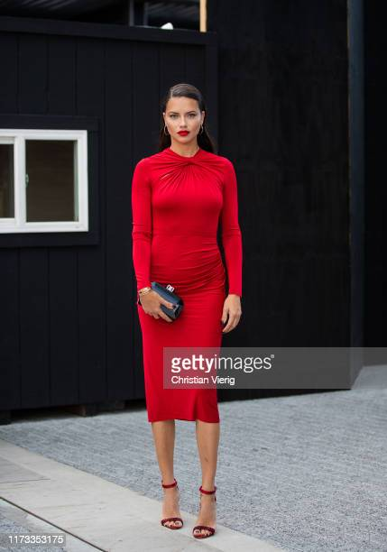 Adriana Lima is seen wearing red dress outside Jason Wu during New York Fashion Week September 2019 on September 08 2019 in New York City