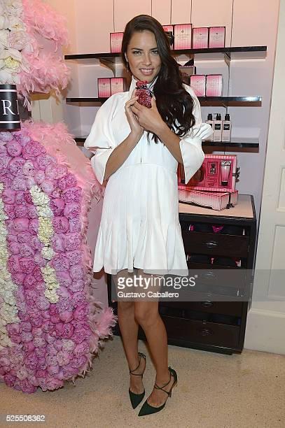 Adriana Lima poses at Victoria's Secret Bombshell Miami at Victoria's Secret Miami on April 28 2016 in Miami Florida