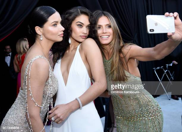 Adriana Lima Shanina Shaik Heidi Klum attends the 26th annual Elton John AIDS Foundation Academy Awards Viewing Party sponsored by Bulgari...