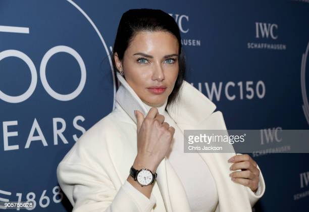 Adriana Lima visits the IWC booth during the Maison's launch of its Jubilee Collection at the Salon International de la Haute Horlogerie on January...