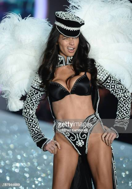 Adriana Lima walks the runway at the 2013 Victoria's Secret Fashion Show at Lexington Avenue Armory on November 13 2013 in New York City