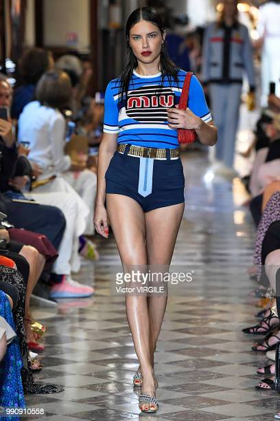Adriana Lima walks the runway during the finale of the Miu Miu 2019 Cruise Collection Show at Hotel Regina on June 30 2018 in Paris France