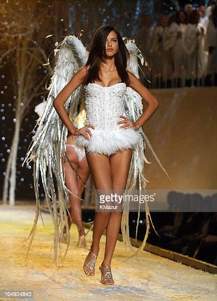 Adriana Lima wearing white Victoria's Secret beaded corset and white Victoria's Secret body bare shimmer bikini
