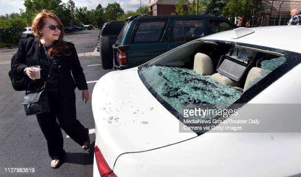 Adriana Ocampo discovers the hail damage on her rental car on Tuesday at the Marriott Residence Inn in Louisville