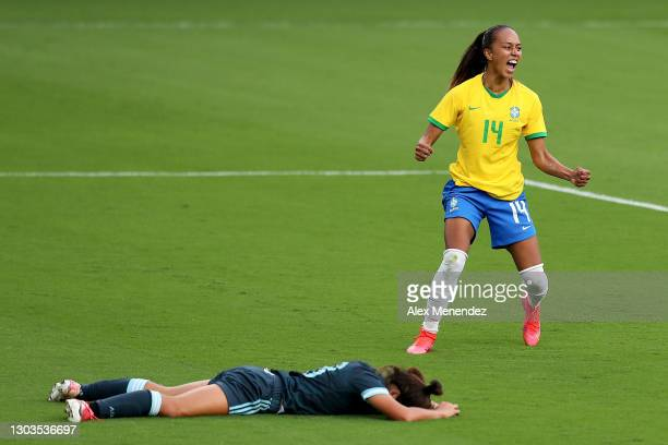 Adriana of Brazil celebrates her goal against Romina Nunez of Argentina during the SheBelieves Cup at Exploria Stadium on February 18, 2021 in...