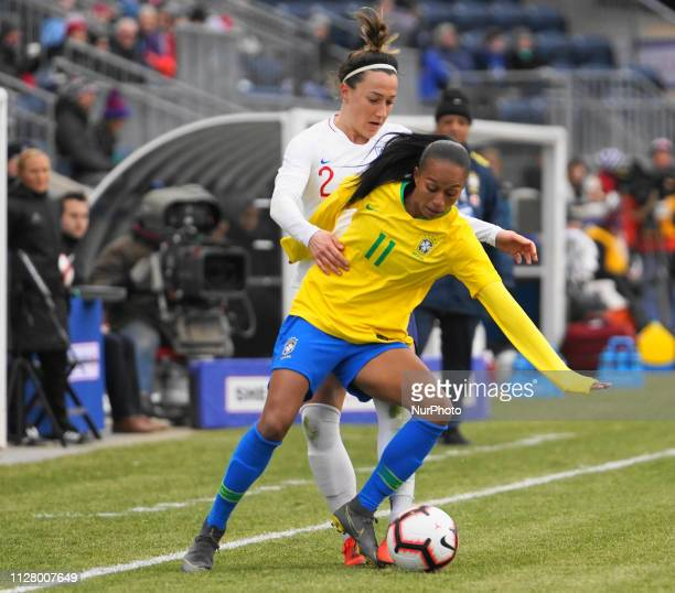 Adriana of Brazil defends the ball against Lucy Bronze of England during the She Believes Cup football match between The United States and Japan at...
