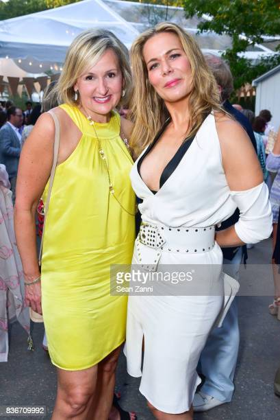 Adriana PidwerBetsky and Erin Gibbs attend ARF's Bow Wow Meow Ball at ARF Adoption Center on August 19 2017 in Wainscott NY