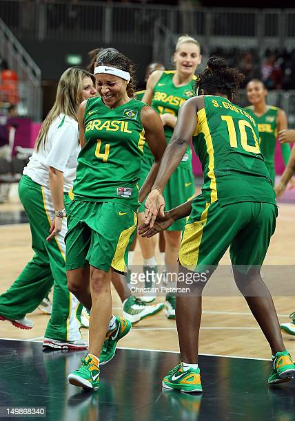 Adriana Pinto of Brazil is spanked by teammates to honor her final game with the Brazil National Team follwoing the Women's Basketball Preliminary...