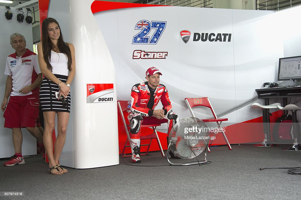 Adriana Stoner and Casey Stoner of Australia look on in box during the MotoGP Tests In Sepang at Sepang Circuit on February 2, 2016 in Kuala Lumpur, Malaysia.
