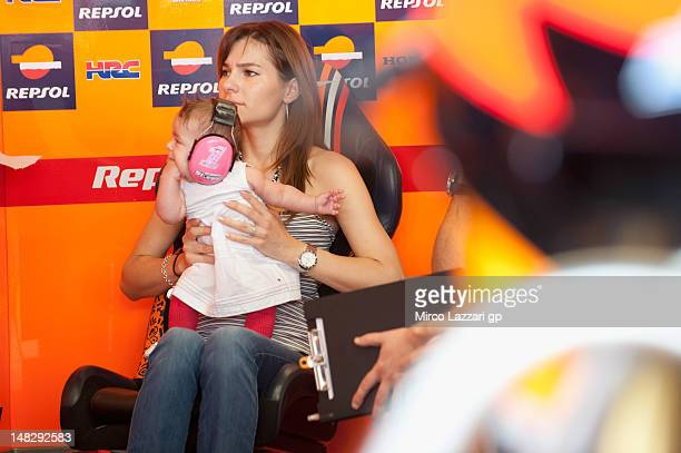 Adriana Stoner and her daughter Alessandra Maria Stoner wait in box during the free practice of the MotoGp of Italy at Mugello Circuit on July 13...
