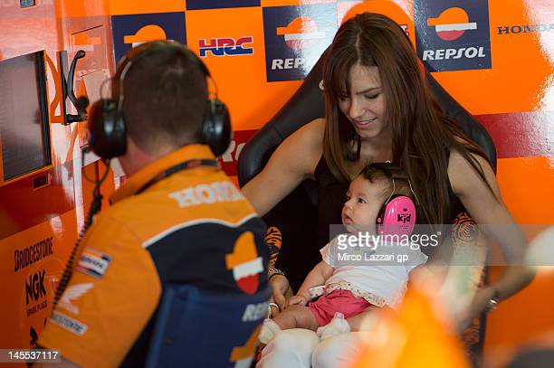 Adriana Stoner of Australia and Repsol Honda Team holds her daughter Alessandra Maria in box during the free practice of the MotoGp Of Catalunya at...