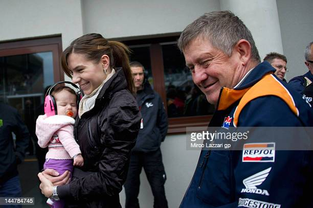 Adriana Stoner of Australia and Repsol Honda Team smiles with her daughter Alessandra Maria and the father of Casey Stoner at the end of the...