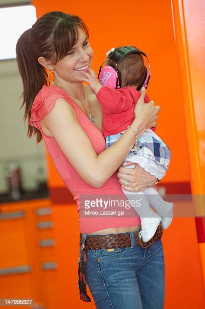 Adriana Stoner of Australia looks on in box with her doughter Alessandra Maria during the qualifying practice of the MotoGp of Germany at Sachsenring...