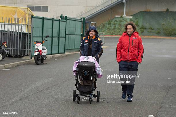 Adriana Stoner walks in paddock with her doughter during the MotoGp Of France on May 17 2012 in Le Mans France
