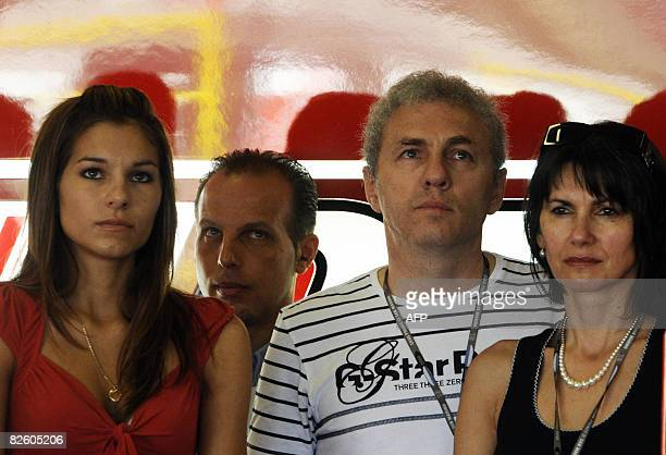 Adriana Stoner wife of Australian world champion MotoGP racer Casey Stoner with her father Jano Tuchyna and her mother Vlasta looks at the display...