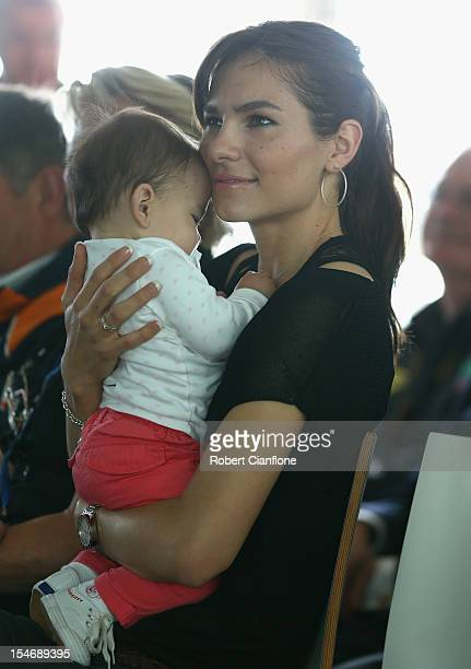 Adriana Stoner wife of Casey Stoner looks on with her baby daughter Alessandra Maria during a press conference to announce turn three of the Phillip...