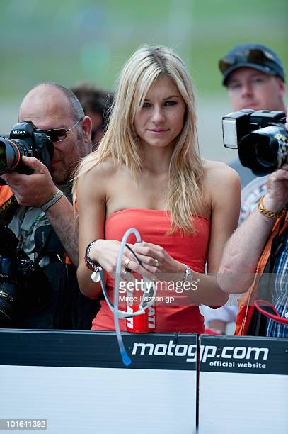 Adriana Stoner wife of Casey Stoner of Australia and Ducati Marlboro Team waits him after during the qualifying practice of the Grand Prix of Italy...