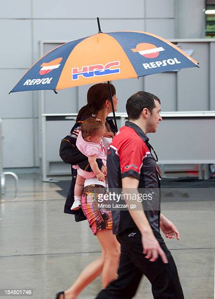 Adriana Stoner wife of Casey Stoner of Australia and Repsol Honda Team walks with Alessandra Maria under the podium of the MotoGP race during the...