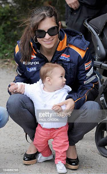 Adriana Stoner wife of Honda rider Casey Stoner of Australia plays with their daughter Alessandra during a media event in the leadup to the...