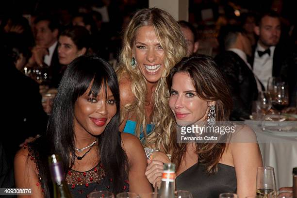 Adriane Galisteu Naomi Campbell and Ana Paula Junqueira attend the 5th Annual amfAR Inspiration Gala at the home of Dinho Diniz on April 10 2015 in...