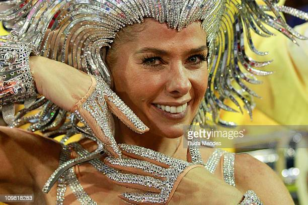 Adriane Galisteu, queen of the drums of Unidos da Tijuca, dances during the samba school's parade at Rio de Janeiro's carnival on on March 06, 2011...