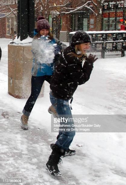 Adrianna Baraco left throws snow at Nina Duerst along the Pearl Street Mall on Thursday