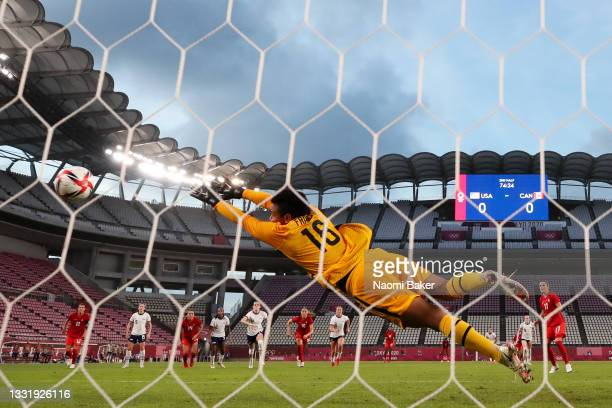 Adrianna Franch of Team United States fails to save a penalty from Jessie Fleming of Team Canada as she goes on to score her side's first goal during...
