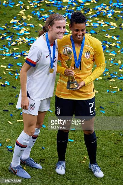 Adrianna Franch of the USA poses with the FIFA World Cup trophy next to her teammate Tierna Davidson of the US of the USA during the 2019 FIFA...