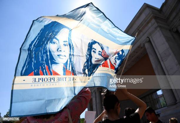 Adrianna GonzalezIbarra shows her support during the Families Belong Together immigration rally and march at Civic Center Park June 30 2018