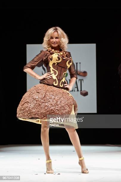 Adrianna Karembeu performs on stage during the parade of the 2012 Salon du Chocolat at the Porte de Versailles October 30 2012 in Paris France