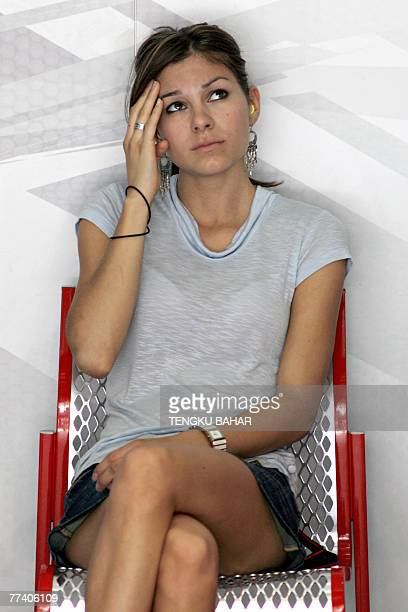 Adrianna Stoner, wife of Australian rider Casey Stoner of Ducati, sits in the team paddock during the first free practice session at the Sepang...