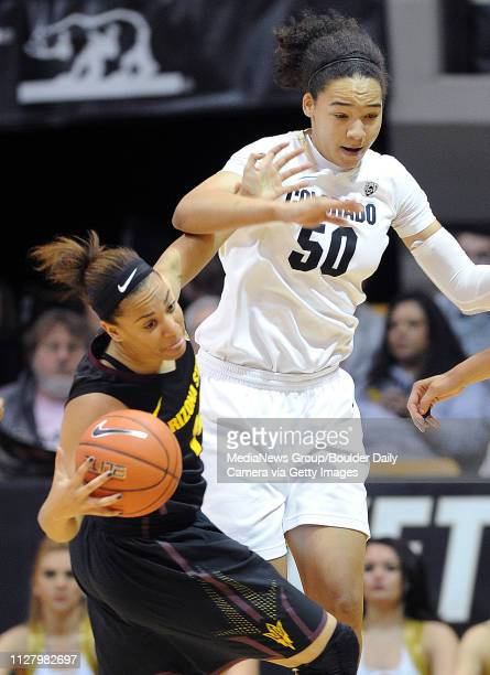 Adrianna Thomas of Arizona State tries to keep the ball from Jamee Swan of Colorado during the first half of the January 26 2014 game in Boulder