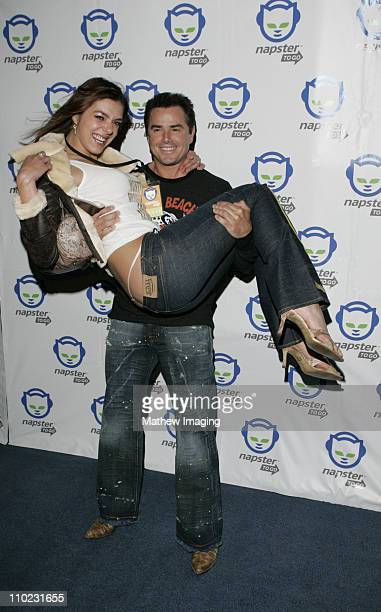 Adrianne Curry and Christopher Knight during Napster To Go Cafe Comes to Los Angeles with Free Digital Music and MP3 Player Giveaways at Mel's...