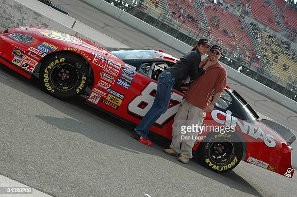 Adrianne Curry and Christopher Knight stand by the Nemco Chevrolet before the Stater Brothers 300 at California Speedway on February 26 2005
