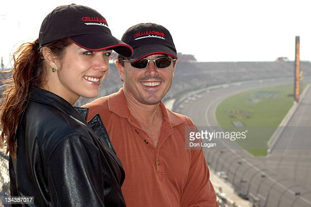 Adrianne Curry and Christopher Knight watch over the Stater Brothers 300 at California Speedway on February 26 2005