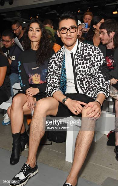 Adrianne Ho and Hu Bing attend the Christopher Raeburn show during London Fashion Week Men's June 2018 at the BFC Show Space on June 10 2018 in...