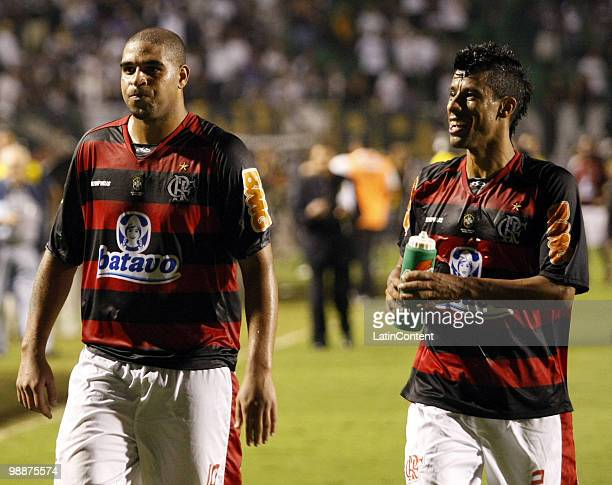 Adriano and Leo of Flamengo celebrate victory over Corinthians during a Libertadores Cup match at Pacaembu stadium on May 5, 2010 in Sao Paulo,...