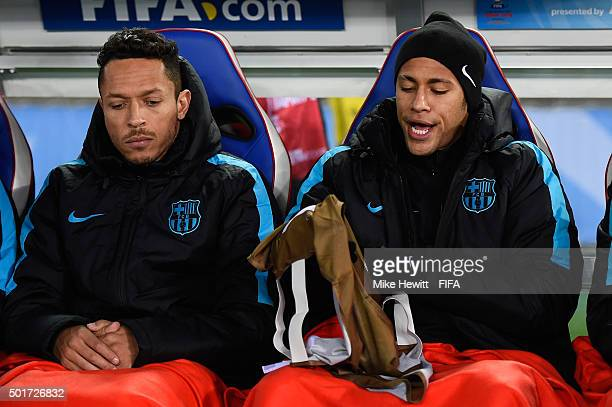 Adriano and Neymar of Barcelona keep warm on the bench during the FIFA Club World Cup Japan 2015 Semi Final match between Barcelona and Guangzhou...