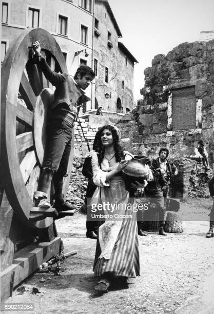 Adriano Celentano acting at the 'Marcello theater' for the musical comedy 'Rugantino' he is tied to a big wheel and Claudia Mori is near him holding...