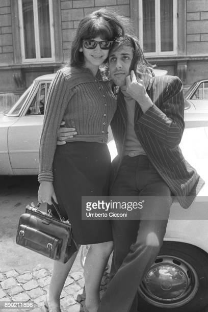 Adriano Celentano jokes with a beautiful woman in Rome in 1967 he is a famous Italian singer composer producer comedian actor film director and TV...