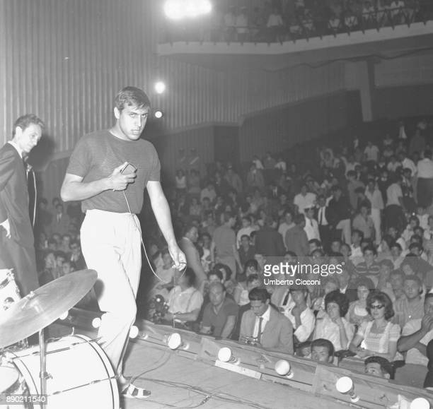 Adriano Celentano sings for the Rock and Roll Festival at the 'Maestoso theater' and Armando Zappi is with him on stage, Rome 1961. Adriano Celentano...