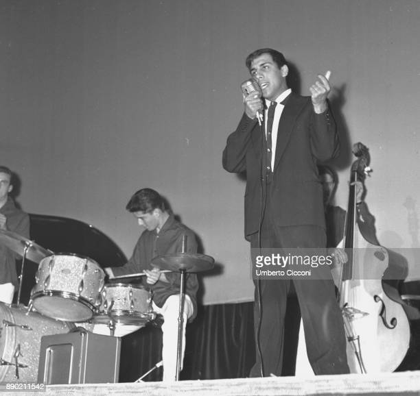 Adriano Celentano while singing on the stage, Rome 1961. Adriano Celentano is a famous Italian singer, composer, producer, comedian, actor, film...