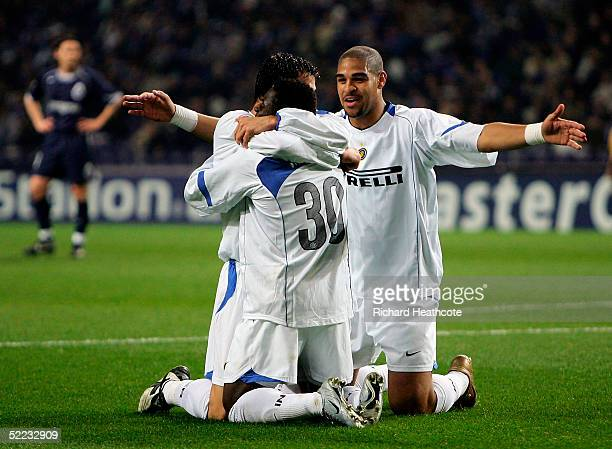 Adriano comes in to congratulate Obafemi Martins on scoring the first goal for Inter during The UEFA Champions League knockout stage 1st leg match...