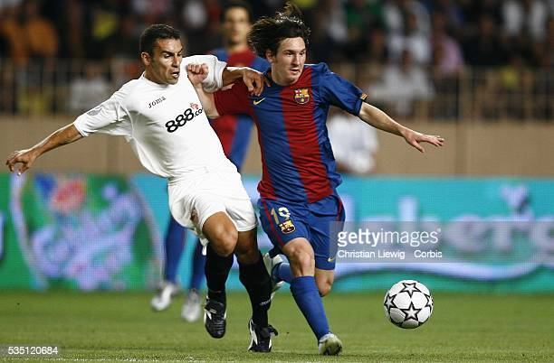 Adriano Correia and Lionel Messi during the 2006 UEFA Super Cup match between FC Barcelona and Sevilla FC