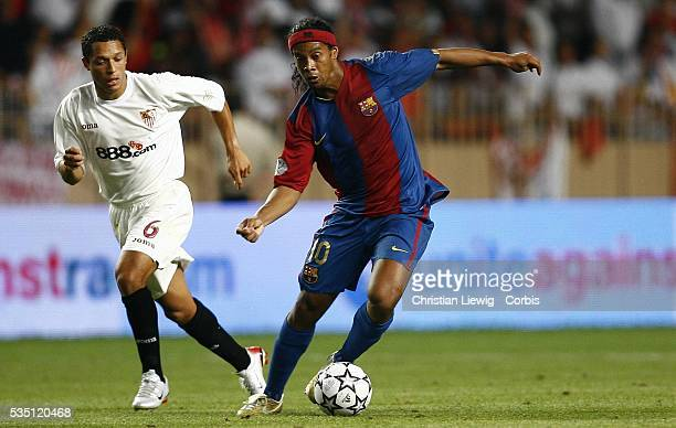 Adriano Correia and Ronaldinho during the 2006 UEFA Super Cup match between FC Barcelona and Sevilla FC