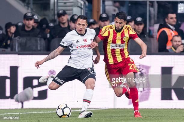 Adriano Correia Claro of Besiktas JK Issam Chebake of Evkur Yeni Malatyaspor during the Turkish Spor Toto Super Lig football match between Besiktas...