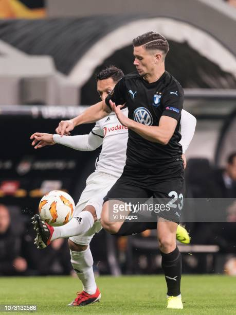 Adriano Correia Claro of Besiktas JK Marcus Antonsson of Malmo FF during the UEFA Europa League group I match between between Besiktas AS and Malmo...