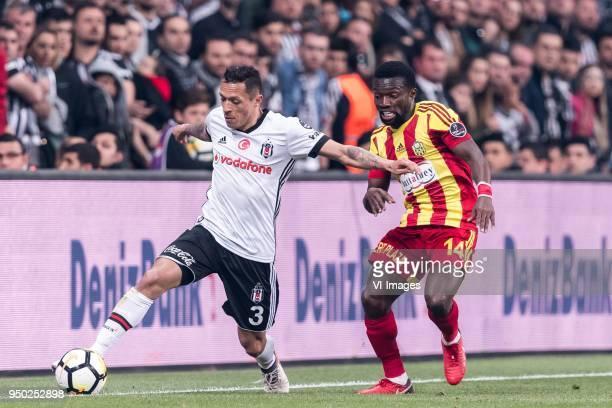 Adriano Correia Claro of Besiktas JK Okechukwu Azubuike of Evkur Yeni Malatyaspor during the Turkish Spor Toto Super Lig football match between...